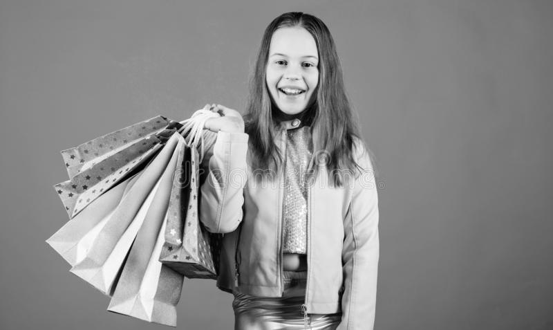 Happy child in shop with bags. Shopping day happiness. Buy clothes. Fashionista addicted buyer. Fashion boutique kids stock image