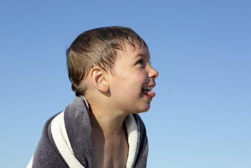Happy child on a sky background stock photo