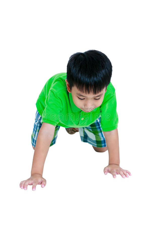 Happy child smiling and crawling on knees. Isolated on white background. Happy child smiling and crawling on knees. Stylish asian boy having fun at studio stock photos