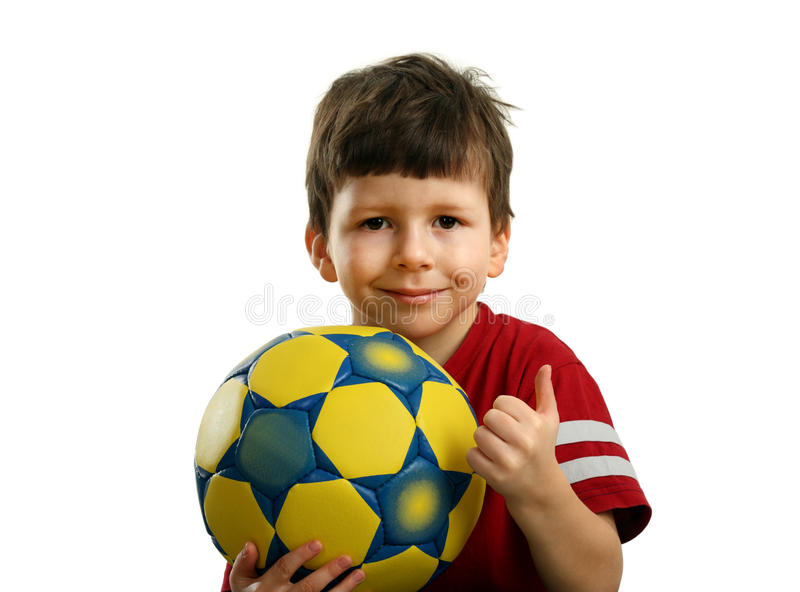 Happy child with soccer ball and shows OK stock images
