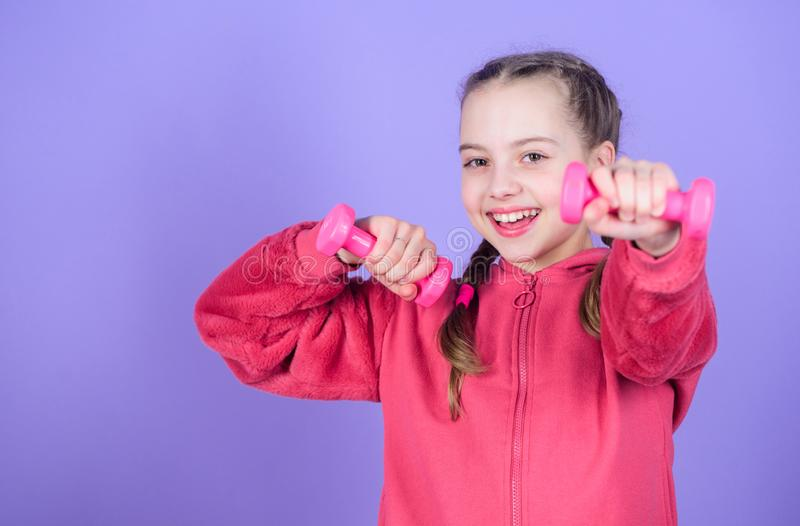 Happy child sportsman with barbell. Fitness diet for energy health. workout of small girl sportsman hold dumbbell. Weight lifting for muscules. Childhood royalty free stock photos