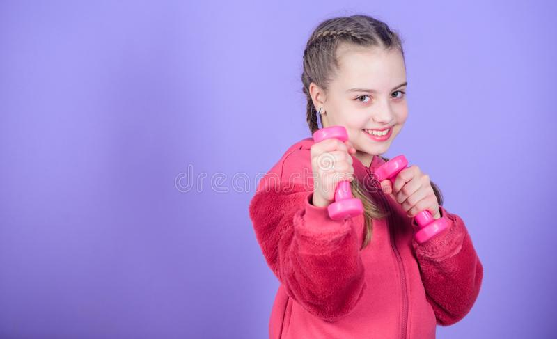 Happy child sportsman with barbell. workout of small girl hold dumbbell. weight lifting for muscules. Childhood activity. Fitness diet for energy health. Sport stock photos
