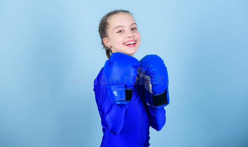 Happy child sportsman in boxing gloves. Fitness diet. energy health. workout of small girl boxer. punching knockout. Childhood activity. Sport success stock images