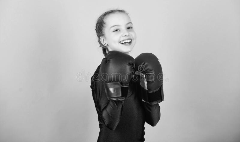 Happy child sportsman in boxing gloves. Fitness diet. energy health. workout of small girl boxer. punching knockout. Childhood activity. Sport success stock image