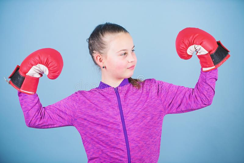 Happy child sportsman in boxing gloves. success. sportswear fashion. punching knockout. Childhood activity. Fitness diet. Energy health. workout of small girl stock photo