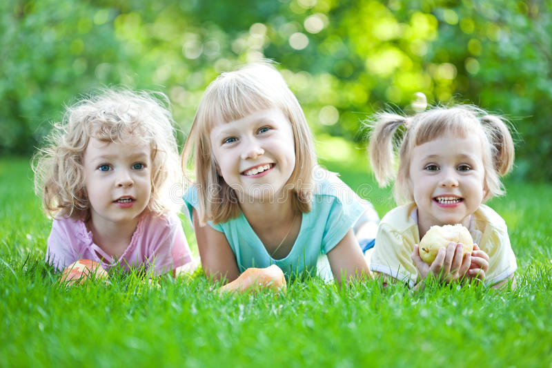 Happy child in spring park. Happy children laying on grass. Family picnic in spring park stock photo