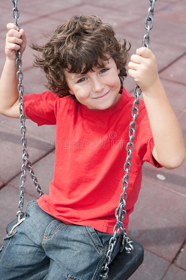 Happy child on the swing stock photography