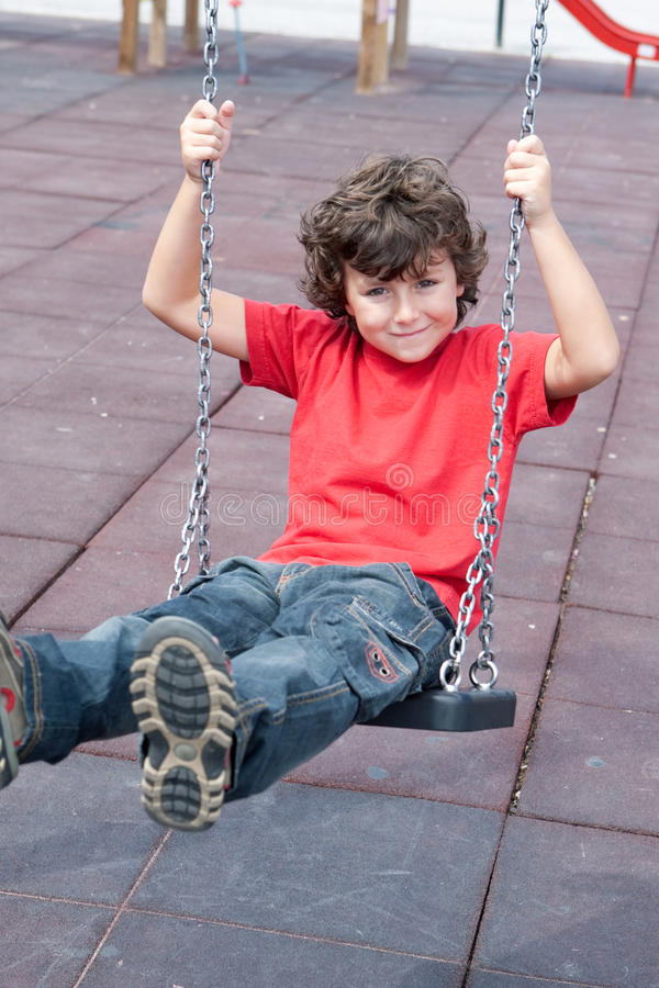 Happy child on the swing royalty free stock image
