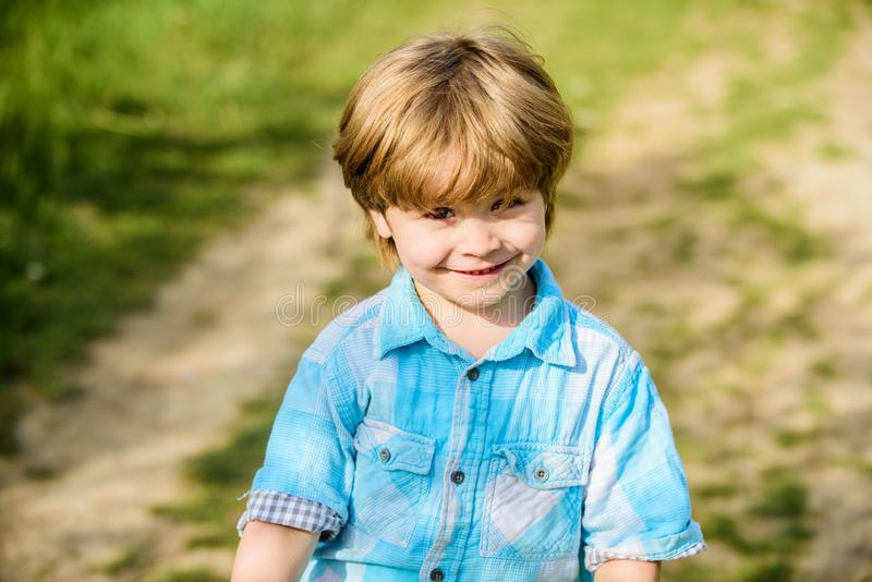 Happy child walking sunny outdoor. spring season. little boy with smile. human and nature. small kid rest in country stock photos