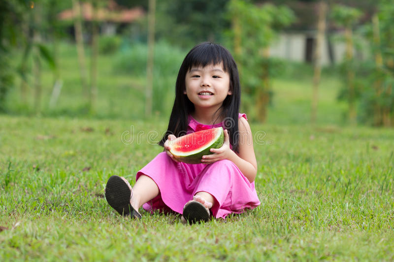 Download Happy Child With Watermelon Stock Photo - Image of bite, field: 24020446