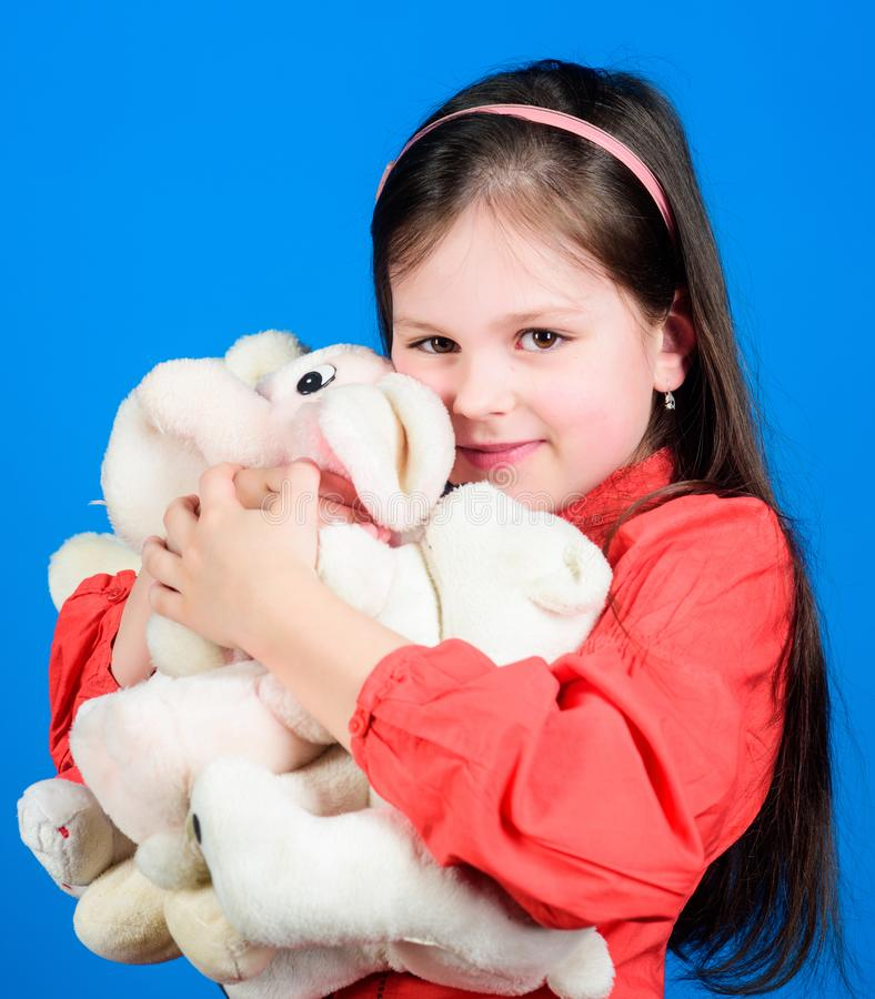 Happy childhood. Birthday. little girl playing game in playroom. toys for kid. small girl with soft bear toy. hugging a. Teddy bear. toy shop. childrens day stock photography
