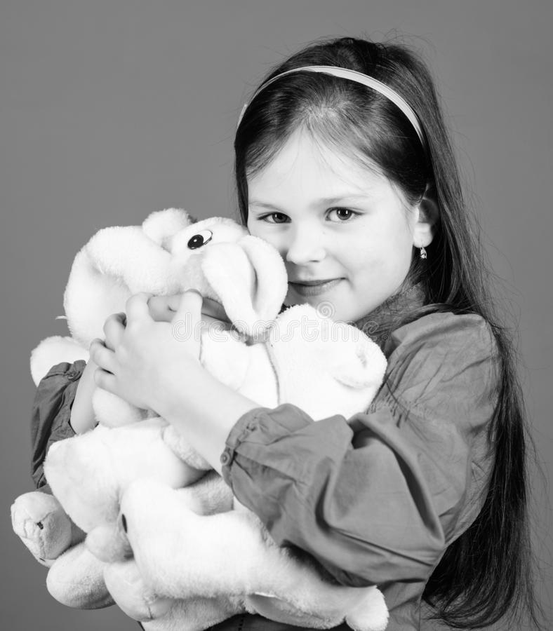 Happy childhood. Birthday. little girl playing game in playroom. toys for kid. small girl with soft bear toy. hugging a. Teddy bear. toy shop. childrens day stock photo