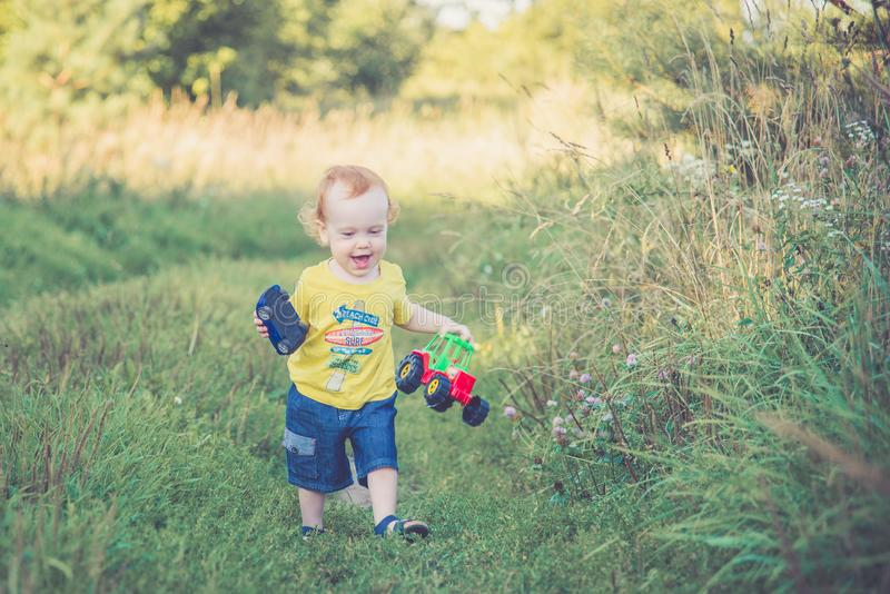 Happy childhood, boy in summer day stock image