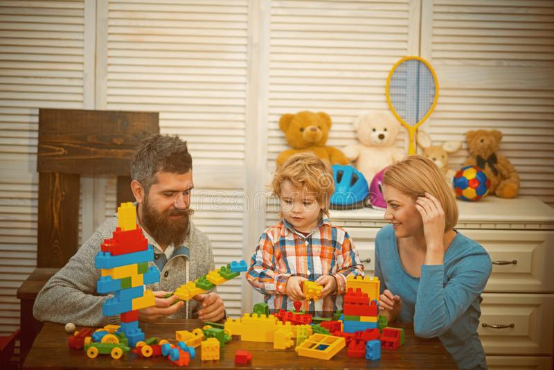 Happy childhood. Care development. little boy play with parents at home. happy family and childrens day. father and. Mother with child play constructor. Little stock photography