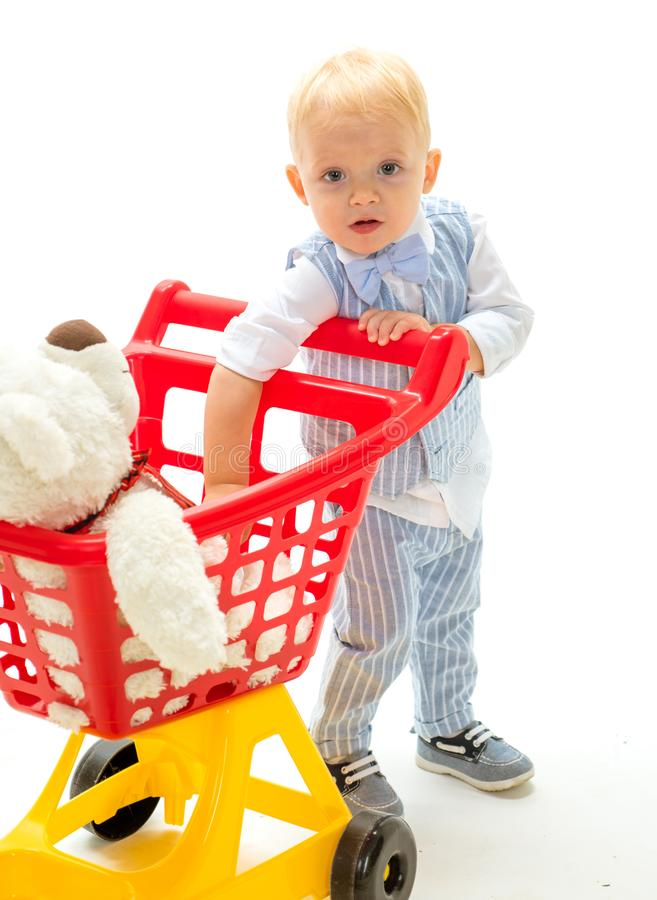 Happy childhood and care. shopping for children. little boy child in toy shop. little boy go shopping with full cart. Savings on purchases. New arrivals. Real stock photos