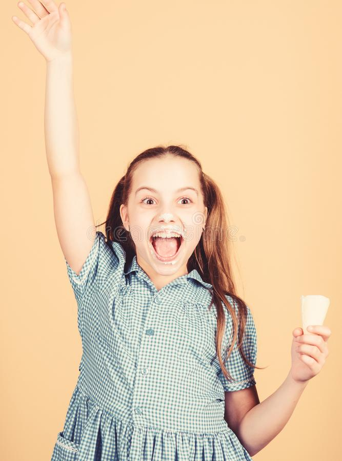 Happy childhood. Carefree kid enjoy sweet ice cream. International childrens day. Sweet tooth concept. Girl little child royalty free stock image