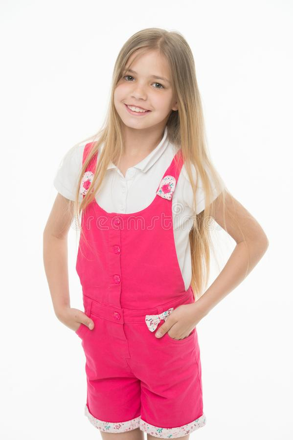 Happy childhood and childcare. Small girl smile in pink jumpsuit isolated on white. Child smiling with long blond hair stock photography