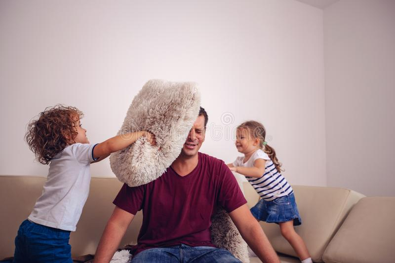 Happy childhood - children boy and girl playing with father together at home. stock images