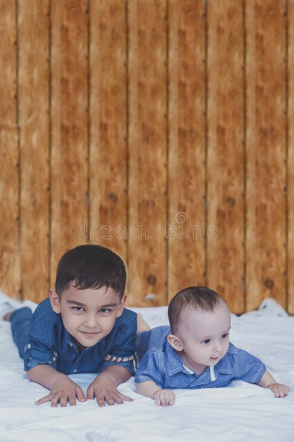 Happy childhood concept. Happy brothers portrait. 6 years and 6 months old boys having fun. Two little kids smiling having good. Time. Cute little brothers stock photos