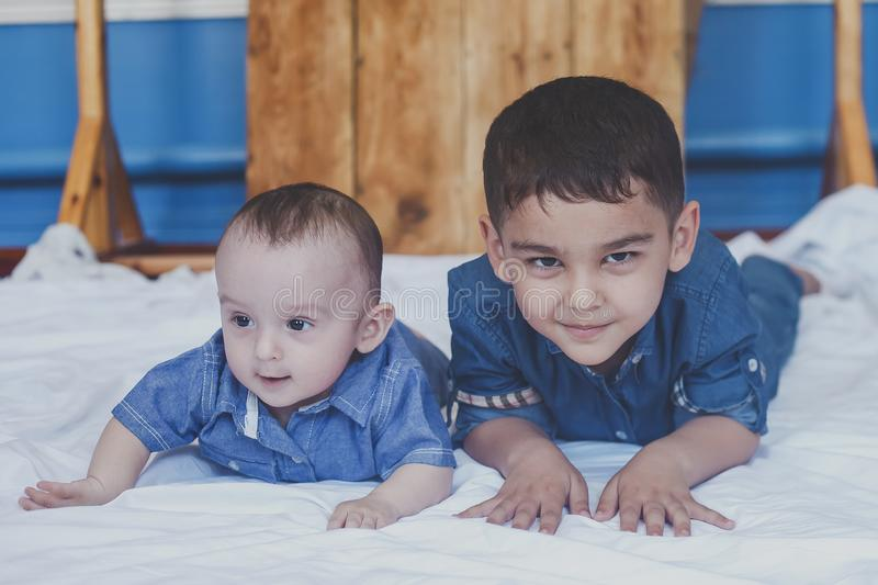 Happy childhood concept. Happy brothers portrait. 6 years and 6 months old boys having fun. Two little kids smiling having good. Time. Cute little brothers royalty free stock photos
