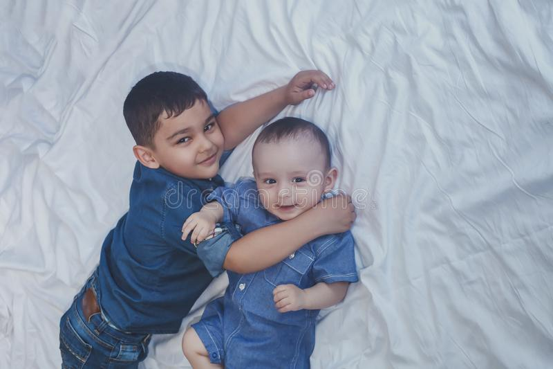 Happy childhood concept. Happy brothers portrait. 6 years and 6 months old boys having fun. Two little kids smiling having good. Time. Cute little brothers lnd stock photos