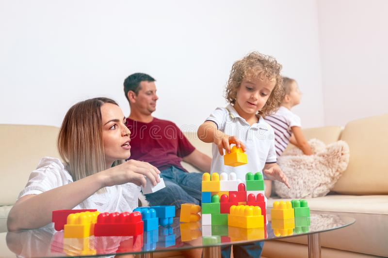 Happy childhood - cute boy playing with woman at home royalty free stock images
