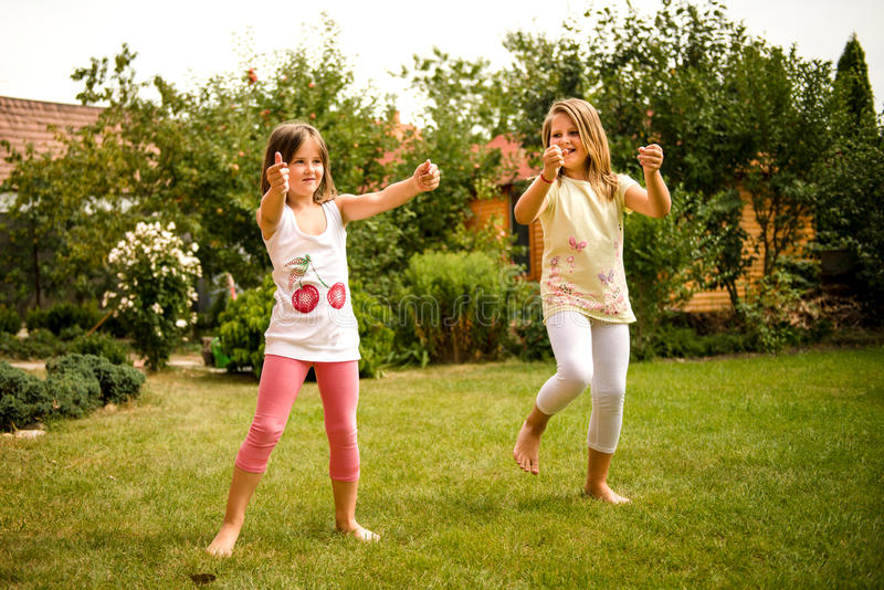 Happy childhood - dancing children royalty free stock images