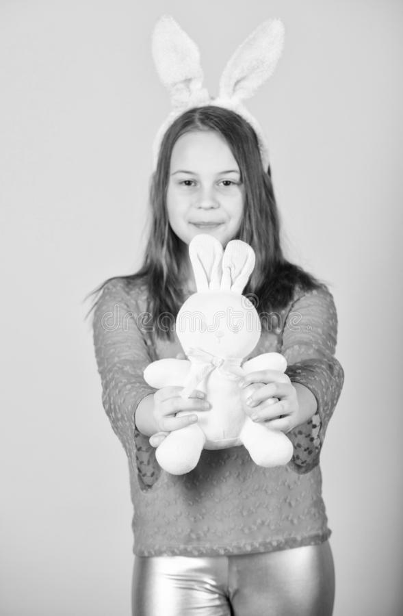 Happy childhood. Easter activities for children. Holiday bunny little girl with long bunny ears. Child cute bunny royalty free stock photos