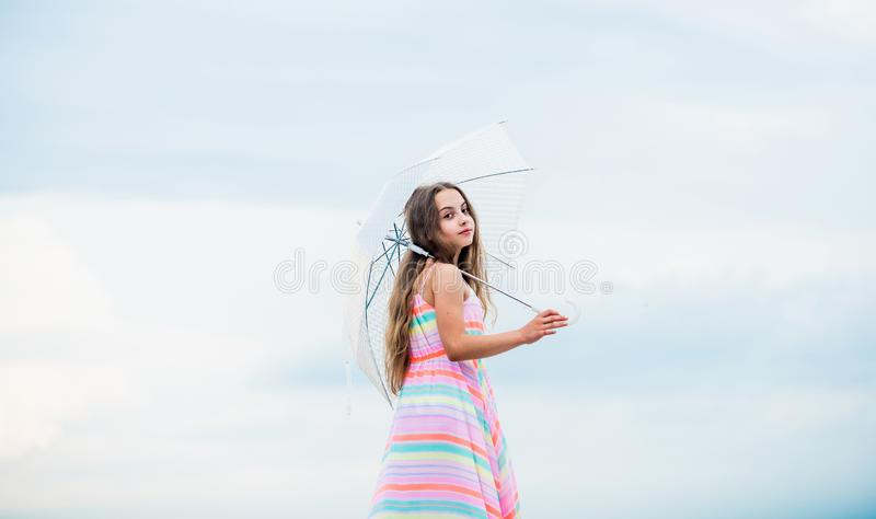 Happy childhood. I believe i can fly. Touch sky. Fairy tale character. Feeling light. Girl with light umbrella. Anti. Gravitation. Fly drop parachute. Dreaming royalty free stock images
