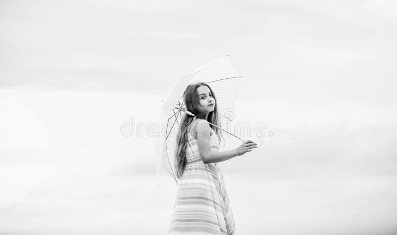 Happy childhood. I believe i can fly. Touch sky. Fairy tale character. Feeling light. Girl with light umbrella. Anti. Gravitation. Fly drop parachute. Dreaming stock photography
