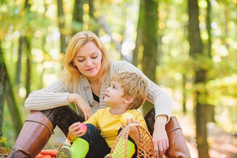 Happy childhood. Mom and kid boy relaxing while hiking forest. Family picnic. Mother pretty woman and little son. Happy childhood. Mom and kid boy relaxing while stock photo