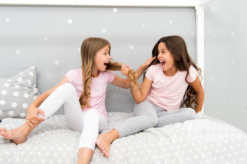 Happy childhood moments. Kids girls sisters best friends full of energy in cheerful mood. Grow strong and healthy hair stock images