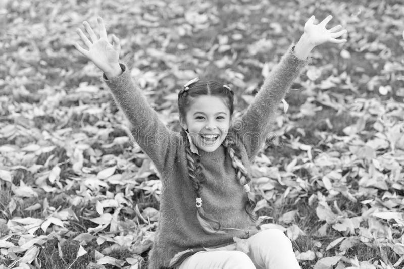 Happy childhood. School time. Autumn leaves and nature. Small child with autumn leaves. Happy little girl in autumn stock image