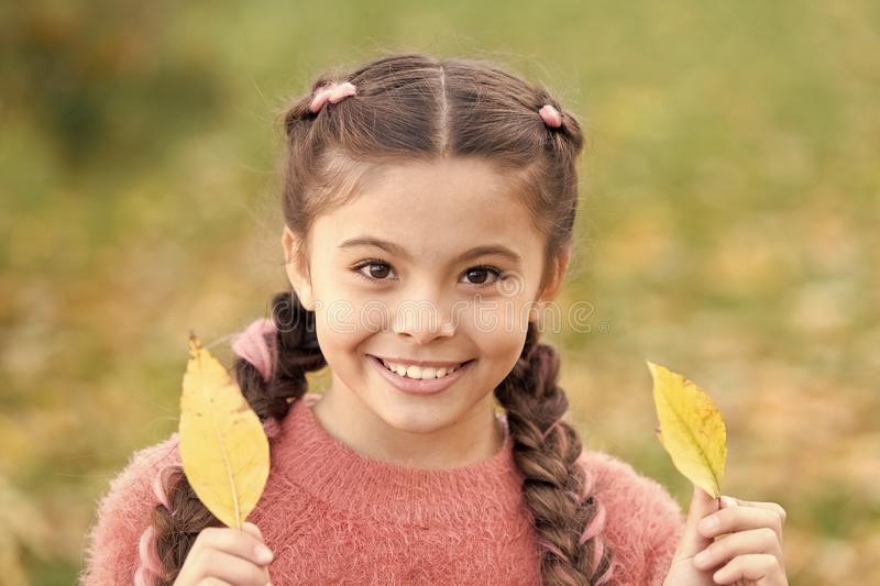 Happy childhood. School time. Small child with autumn leaves. smiling little girl in autumn forest. Autumn leaves and royalty free stock images