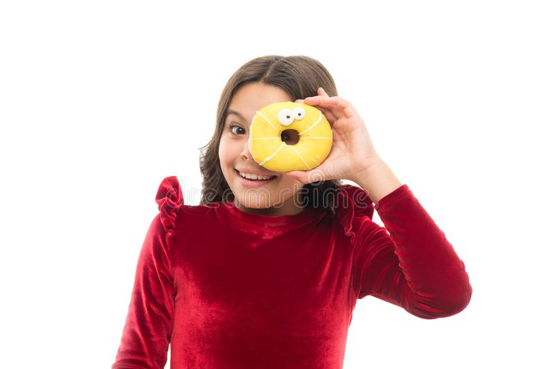 Happy childhood and sweet treats. Breaking diet concept. Girl hold sweet donut white background. Child hungry for sweet stock image