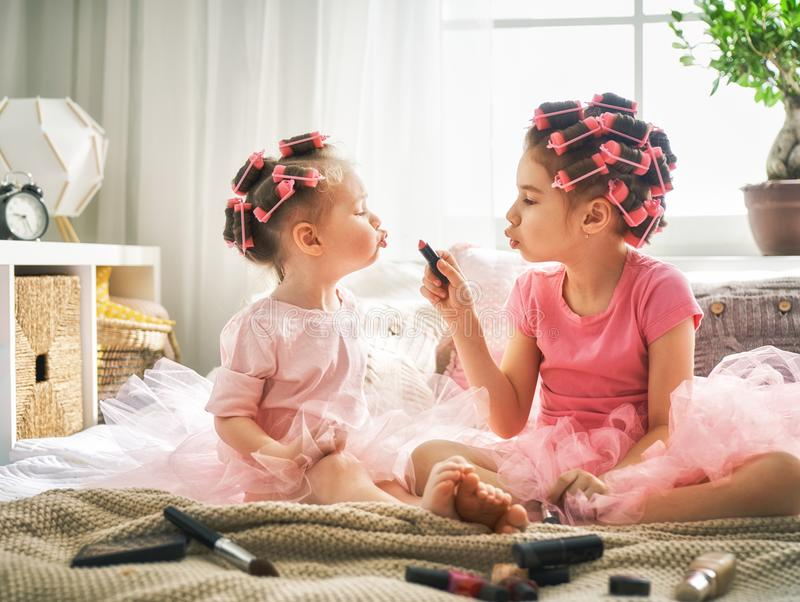 Sisters are doing hair and having fun royalty free stock photography