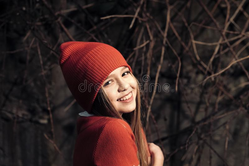 Happy childhood and youth. Small girl smile in red hat, fashion. Child smiling with long blond hair outdoor, beauty. Kid royalty free stock images