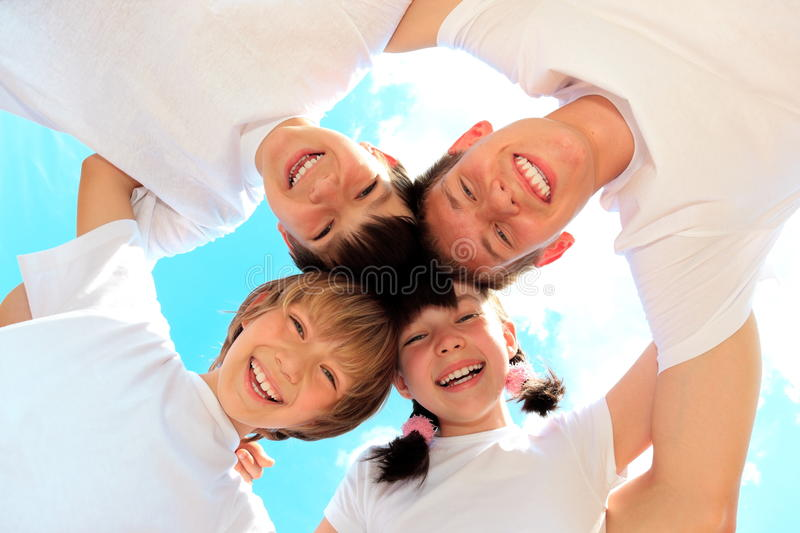 Happy Children. A portrait of happy children wearing white clothes, from below stock photos