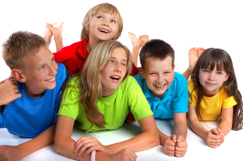 Happy Children. A group of happy kids in bright shirts smiling and posing for the camera royalty free stock photography