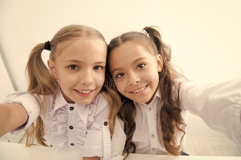 Happy children back to school and making selfie. selfie of happy children in school uniform. cheerful students. pretty stock photo