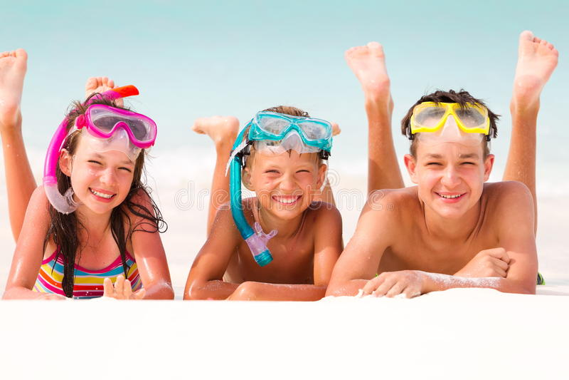 Happy children on beach royalty free stock photo
