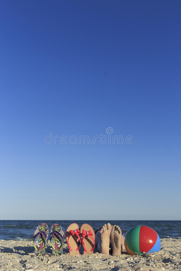 Happy children on the beach during the summer. stock photos
