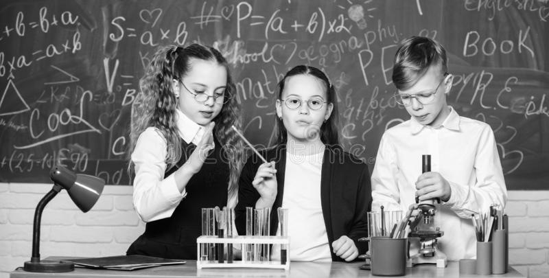 Happy children. Biology lesson. biology education. students doing biology experiments with microscope in lab. Biology. Equipment. Little kids learning chemistry stock images