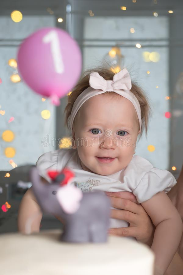Happy children. Birthday party background. Smiling girl and birthday cake. Birthday, one year. One year old little stock photos