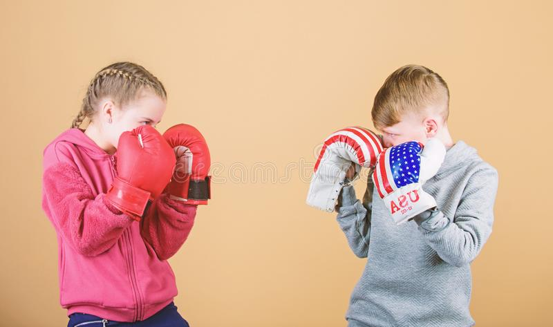 Happy children in boxing gloves. Fitness diet. energy health. punching knockout. activity. Sport success. Friendship. Fight. workout of small girl and boy boxer stock photography