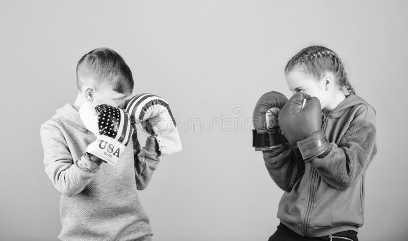 Happy children in boxing gloves. Fitness diet. energy health. punching knockout. activity. Sport success. Friendship. Fight. workout of small girl and boy boxer stock photo