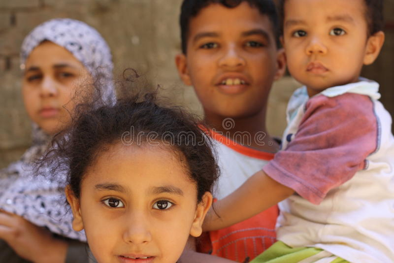Happy children boys playing in the street in giza, egypt royalty free stock image