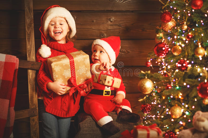 Happy children brother and sister with Christmas present stock photo