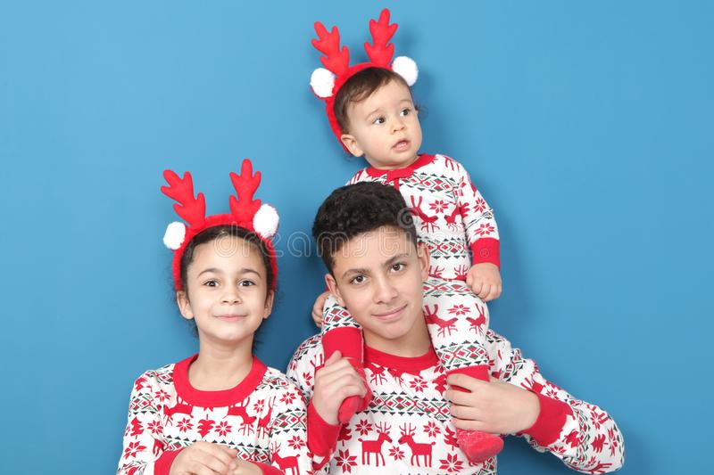 Happy children in Christmas pajamas royalty free stock images