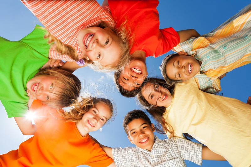 Happy children close in circle on sky background royalty free stock photos